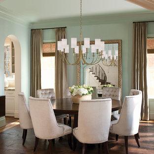 Esempio di una sala da pranzo moderna chiusa e di medie dimensioni con pareti verdi, parquet scuro, nessun camino e pavimento arancione