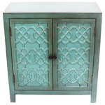 """River of Goods - 28"""" Antiqued Quatrefoil Teal Two Door Cabinet With Shelf - With the character of an antique from the spice trade, this exotic wooden cabinet is the perfect piece for bedrooms, dining rooms, and living rooms. Featuring a teal finish with great patina, this piece has two doors opening up to reveal storage for your most personal belongings. With a fascinating wooden patterned facade, this hand crafted cabinet is sure to add that little bit of flair to tie your space together."""