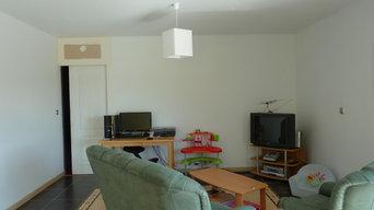 décoration et ameublement d'une pièce à vivre suite à l'aménagement des combles
