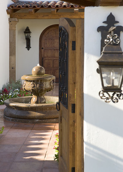 Wooden doors and gates often feature iron details these lanterns are typical spanish revival