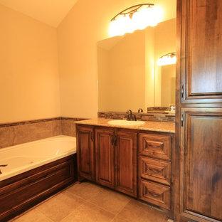 Immagine di una stanza da bagno padronale classica con lavabo da incasso, nessun'anta, ante in legno scuro, top in granito, vasca da incasso, piastrelle multicolore, lastra di vetro e pavimento con piastrelle in ceramica