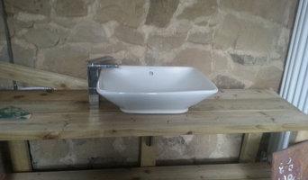 Bespoke bathroom sink, pointing stone walls.
