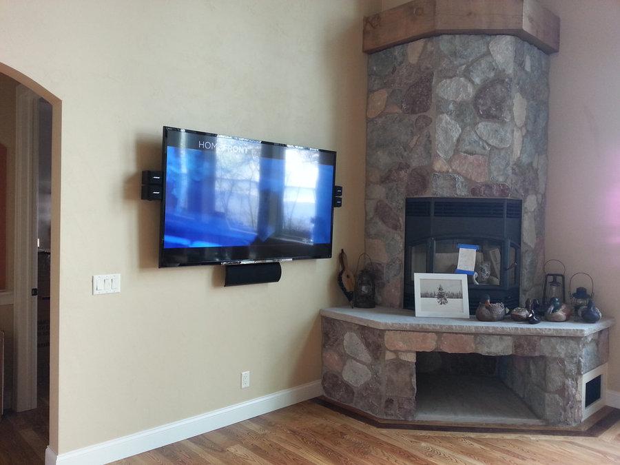 TV Wall Mounted Near corner Fireplace