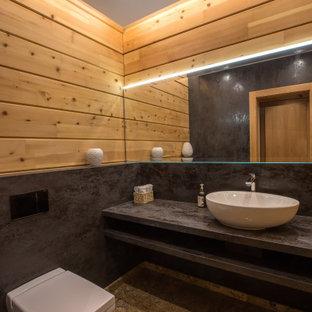 На фото: туалет среднего размера в стиле рустика с плоскими фасадами, коричневыми фасадами, инсталляцией, коричневой плиткой, керамогранитной плиткой, разноцветными стенами, настольной раковиной, столешницей терраццо, разноцветным полом, фиолетовой столешницей, подвесной тумбой, деревянным потолком, деревянными стенами и полом из керамогранита с