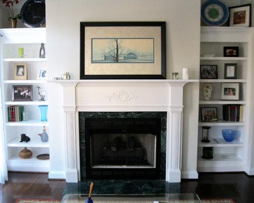 Custom Built Shelf Units on each side of Fireplace
