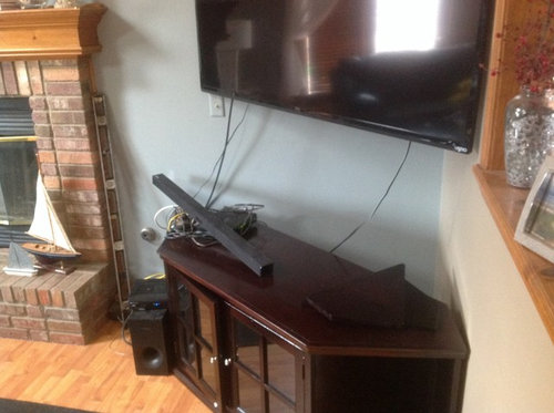 """What to put under 60"""" corner mounted tv to hold cable ..."""