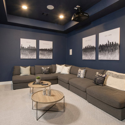 Example of an enclosed carpeted and beige floor home theater design in Houston with a projector screen and blue walls