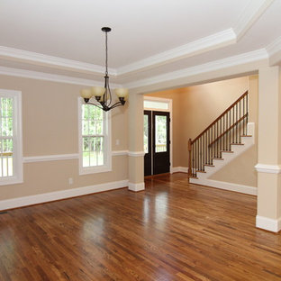 Inspiration for a large country light wood floor great room remodel in Raleigh with beige walls