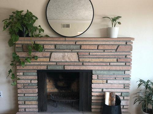 Mirror Above An Offset Fireplace