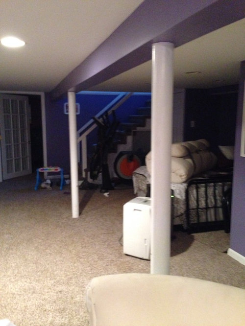 How To Decorate The Load Bearing Posts In The Basement