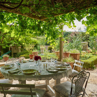 Photo of an expansive farmhouse patio in Gloucestershire.