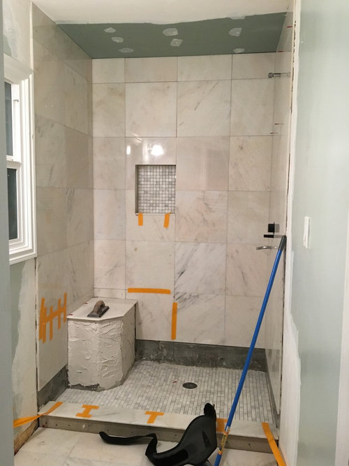 Shower Next To The Shampoo Cubby Tiles That Don T Have Such A Strong Tinge Our New Vanity Is Light Grey What Color Should I Paint Walls