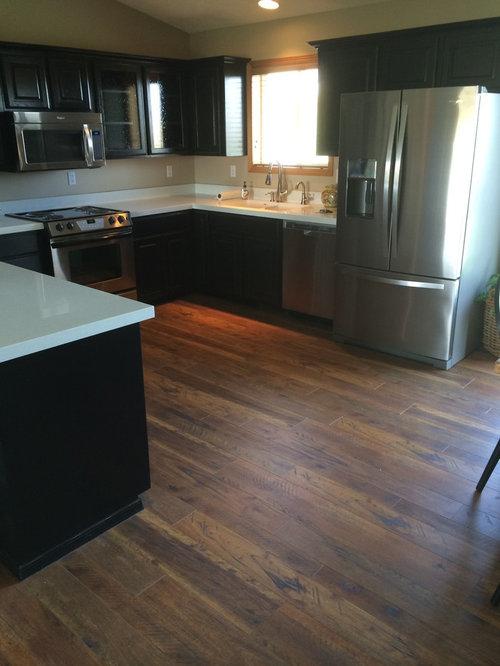 Example Of A Mid Sized Minimalist U Shaped Medium Tone Wood Floor Eat