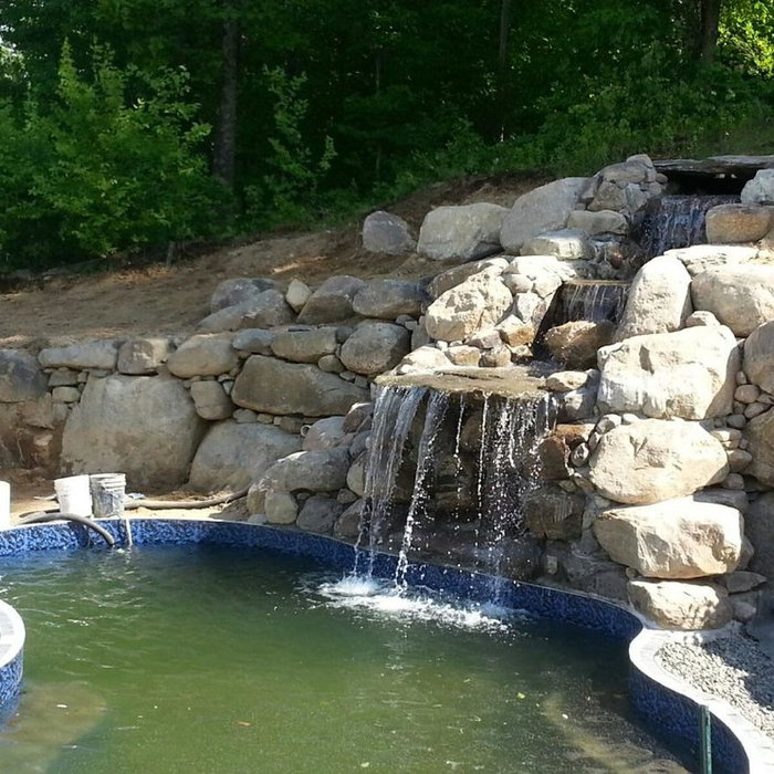Pool waterfalls are the best! Let us design it for you