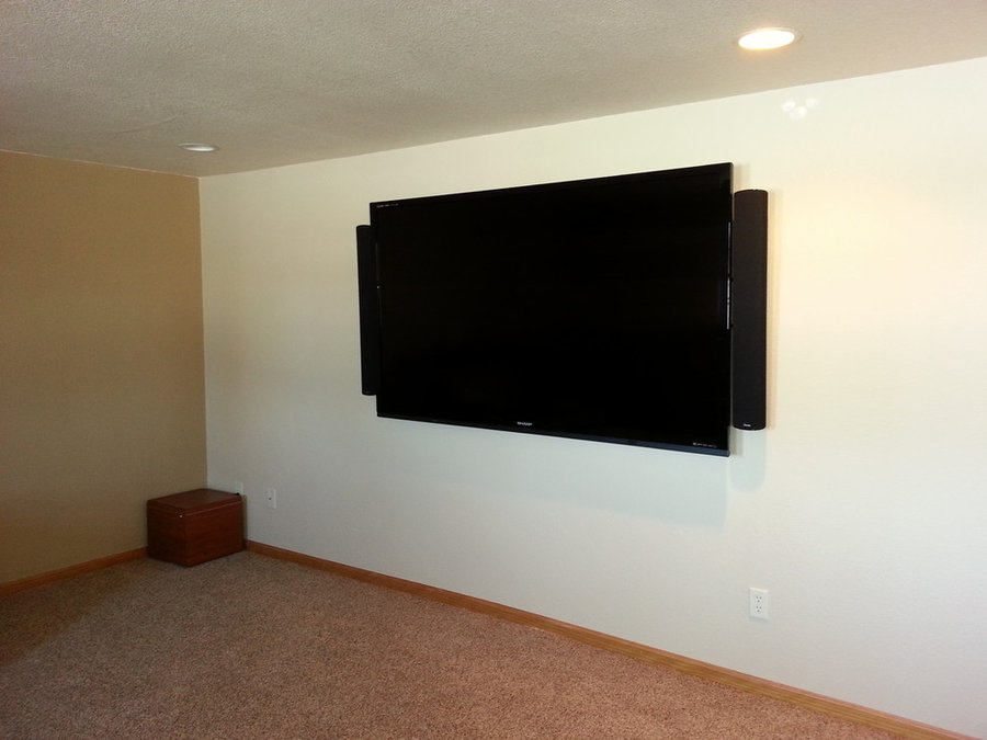 Large Wall-Mounted TV in Basement