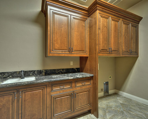Mediterranean Laundry Room Design Ideas, Remodels & Photos with Brown Cabinets