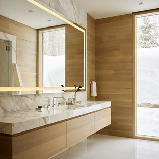 Inspiration for a modern master bathroom in Other with flat-panel cabinets, a single vanity, a floating vanity and wood walls.