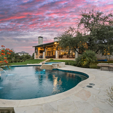 Freeform Pool with Spa and Scuppers in Texas Hill Country