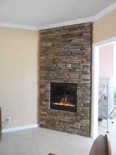 Reasonable price for new gas fireplace with stone surround