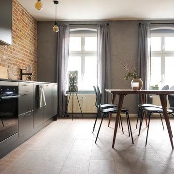 Industrieller Backstein Look kombiniert mit Grautönen und edlem Holz auf 90 qm