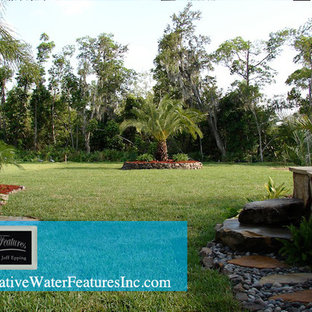Inspiration for a large tropical home design remodel in Orlando