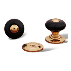 Polished Brass RKI Black Porc. Knob with Brass Tip, RKICK317