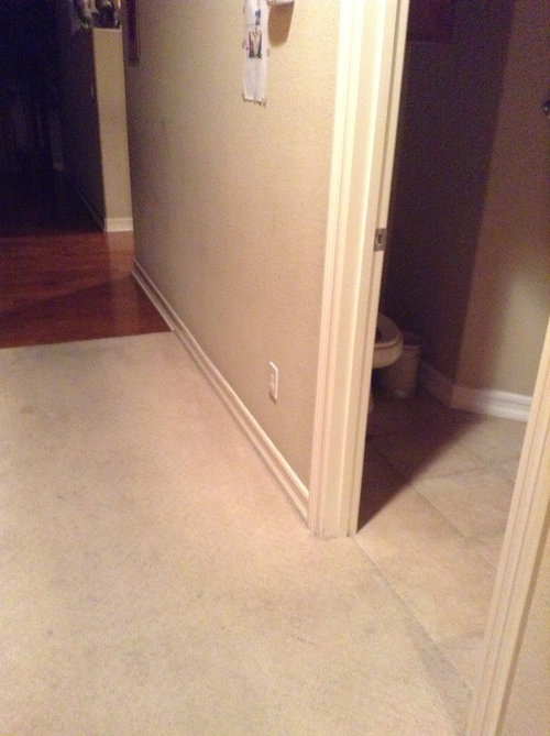 Should Hallway Tile Transition Into Bathrooms And Laundry