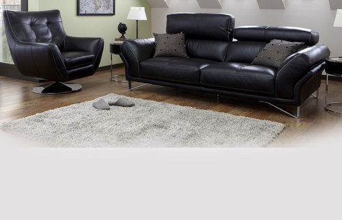 What colour of cushions go with a black leather sofa?