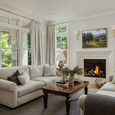 Inspiration for a mid-sized transitional formal and open concept medium tone wood floor and gray floor living room remodel in San Francisco with white walls, a standard fireplace, a plaster fireplace and no tv