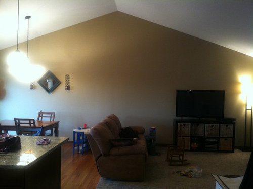 Wall art? a clock? We also don\u0027t have a ton of money for decor right now since we are finishing the basement so try to be frugal;) Thank you so much!! & What to do with large vaulted ceiling wall?!