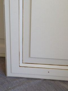 Match white cabinet paint color to trim exactly or shift a shade?
