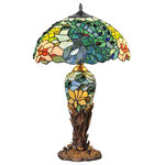 """River of Goods - 26"""" Fantastic Feodora Stained Glass Double Lit Table Lamp - Absolutely Fab! This stained glass lamp resembles a gorgeous peacock with multi-colored feathers delicately formed from 360 hand-cut glass pieces and 12two jewel-toned cabochons. The lamp is so intricately crafted that it appears to be emerging from its base, which is shaped like leaves and peacock feathers. The base and the shade can be lit separately, allowing you to use the base as a night light or accent lamp. This lamp is sure to attract attention and will be a stunning addition to any space you choose!"""