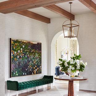 Свежая идея для дизайна: большое фойе в стиле неоклассика (современная классика) с белыми стенами, паркетным полом среднего тона, двустворчатой входной дверью, входной дверью из светлого дерева, коричневым полом, балками на потолке и кирпичными стенами - отличное фото интерьера