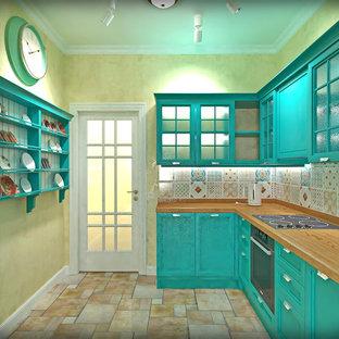 На фото: со средним бюджетом отдельные, линейные кухни среднего размера в средиземноморском стиле с врезной раковиной, фасадами с выступающей филенкой, бирюзовыми фасадами, столешницей из дерева, разноцветным фартуком, фартуком из керамической плитки, черной техникой, полом из керамогранита, разноцветным полом и оранжевой столешницей без острова
