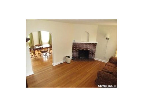 tiny living room with corner fireplace