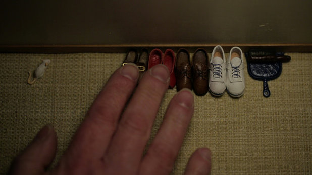"Miniature shoes, ""Who Lives There"""