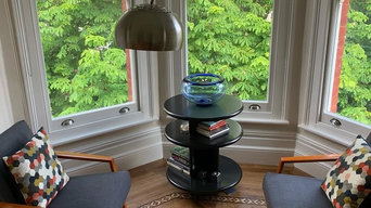 Two mid century chairs and ebonnised deco style table.