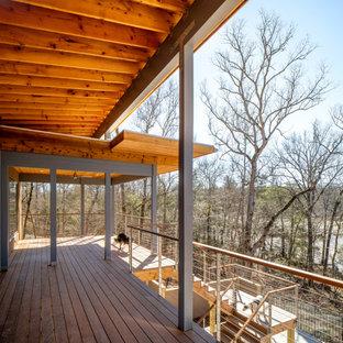 Ispirazione per un ampio portico moderno dietro casa con un portico chiuso, cemento stampato, un tetto a sbalzo e parapetto in cavi