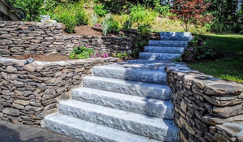 Stone wall and granite stair set install