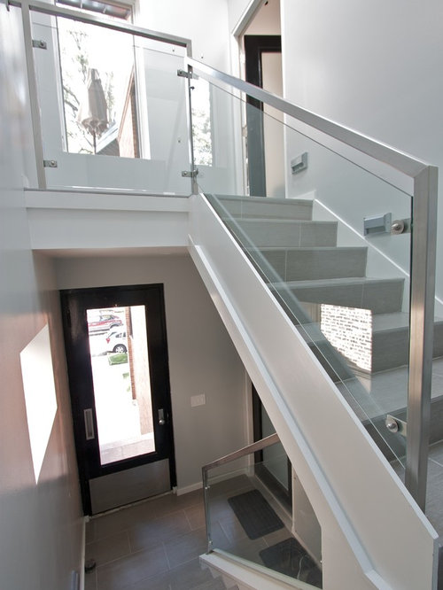 small tile ushaped glass railing staircase idea in chicago