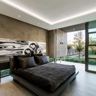 This is an example of a contemporary master bedroom in Sydney.