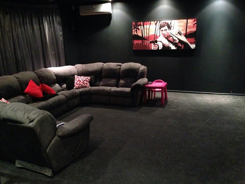 Our Living Room Is A Huge Area Which Very Dark Grey Walls Couch And Carpet The Scarface Print Must Stay Should I Add Red Rug Black Coffee Table