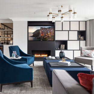 Inspiration for a traditional enclosed living room in Kent with a home bar, white walls, light hardwood flooring, a ribbon fireplace, a wall mounted tv and beige floors.