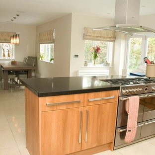 Example of a cottage chic home design design in Surrey