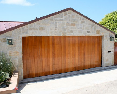 Custom garage doors rustic finishes and reclaimed wood doors for Garage door finishes