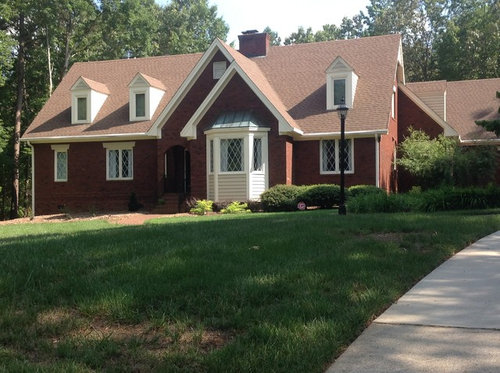 Really RED Brick And Brown Roof Tudor Need Color Ideas.