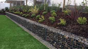 Artificial Grass and Pebble filled Gabion walling