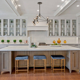 Inspiration for a mid-sized country u-shaped open plan kitchen in San Francisco with a farmhouse sink, shaker cabinets, light wood cabinets, marble benchtops, white splashback, subway tile splashback, stainless steel appliances, medium hardwood floors, with island, brown floor, white benchtop and coffered.