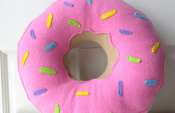 Pink Frosted Doughnut Pillow by Wild Rabbits Burrow