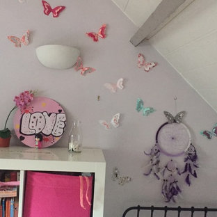 Inspiration for a shabby-chic style girl kids' room remodel in Paris with purple walls